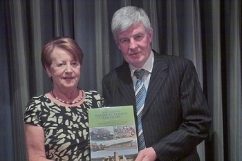 Paddy presenting Nuala who launched the book with the first copy