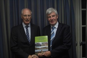 Paddy Lawlor presenting Cathal Flood Editor with a copy of the book